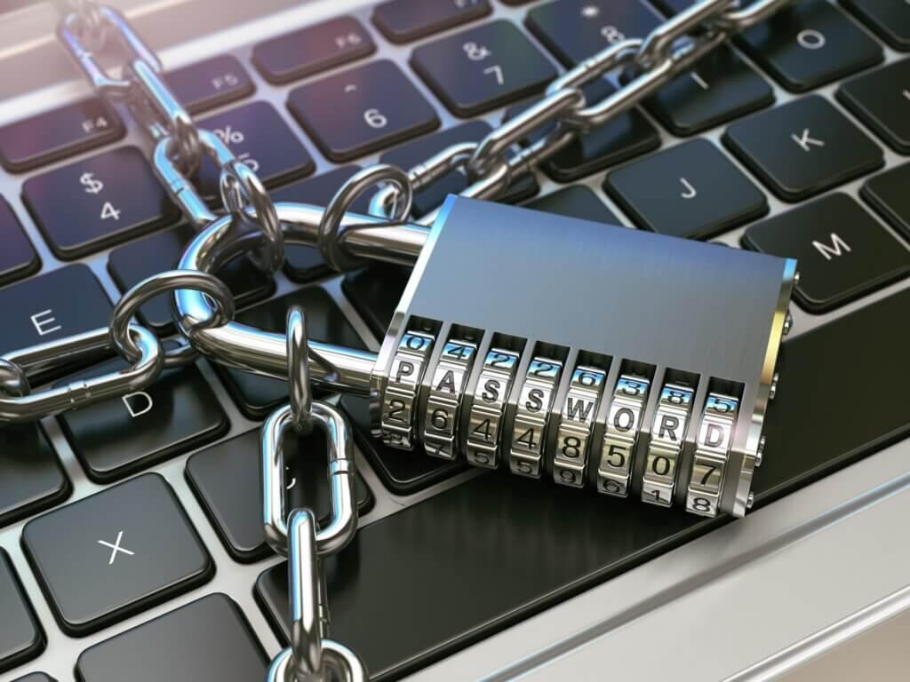 """Capa do artigo Avaliação de riscos em fornecedores com um teclado e um cadeado onde se lê a palavra password, que em português significa """"senha""""."""
